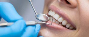Close-up healthy smile with dental tools