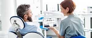 Agawam implant dentist and patient discuss dental implants