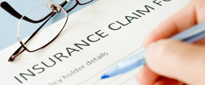 Patient filling in insurance claim form