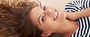 woman laying on floor smiling
