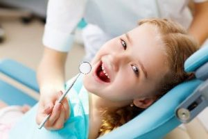 Smiling child in the dental chair.
