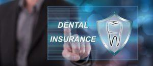 Dental insurance on screen at dentist office.