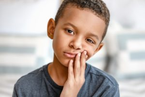 Boy with toothache needs to see his dentist