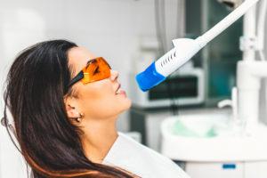 woman undergoing teeth whitening process